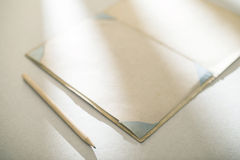 Vintage pencil and drawing paper. Weak sunlight Royalty Free Stock Image