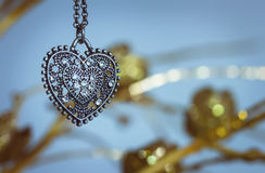 Vintage pendant. In the shape of hearts, hanging from a chain stock photo