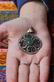 Vintage pendant in hand Royalty Free Stock Images