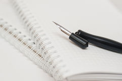 Vintage penholder. Old and used writing pen with ink metal head Royalty Free Stock Photography