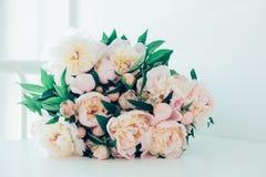 Vintage peony bouquet on white table Stock Photos