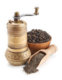 Vintage pepper mill and black peppercorn Stock Photo