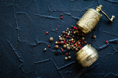 Vintage pepper mill and peppercorns Stock Image