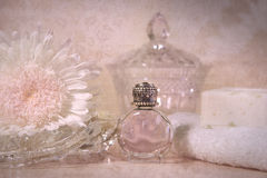 Vintage perfume bottle with flower Stock Photos
