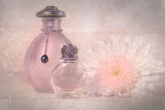 Vintage perfume bottles with flower Royalty Free Stock Photography
