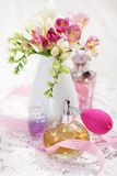 Vintage perfume bottles and flowers Royalty Free Stock Photos