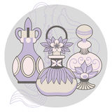 Vintage perfume bottles. Purple and pink vintage perfume bottles, decorated with flowers and leaves in circle Stock Images