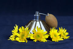 Vintage perfume sprayer with yellow flowers Royalty Free Stock Image