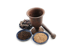 Vintage pestle with flax seeds,black pepper and beans Stock Images