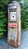 Vintage Petrol Pump. Rusty vintage petrol pump with No Smoking sign stock photos