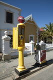 Vintage petrol pumps on the kerbside South Africa Stock Photo