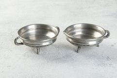 Vintage pewter sauce boats on concrete background. Copy space for text royalty free stock photography