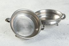 Vintage pewter sauce boats on concrete background. Copy space for text stock photos