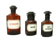 Vintage pharmacy bottles. Three isolated vintage pharmacy bottles Stock Image