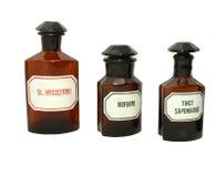 Vintage pharmacy bottles. Three isolated vintage pharmacy bottles stock image