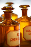 Vintage pharmacy bottles. An image of vintage chemical bottles in a pharmacy stock photo