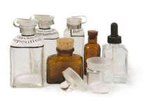 Vintage pharmacys` bottles. Few vintage pharmacys` bottles isolated on white background stock photo