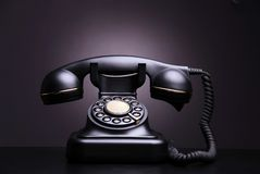 Vintage phone. On dark background royalty free stock photo
