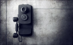 Vintage phone on concrete wall Stock Photo