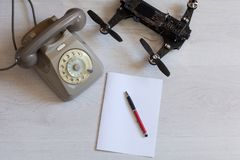 Vintage Phone with drone. Paper, pen Royalty Free Stock Photography