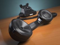 Vintage phone on green background. Hotline support concept. Royalty Free Stock Image