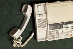 Vintage phone with handset and answering machine. On green velvet,the handset lies next stock photo