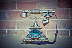Vintage phone isolate is on brick background Stock Image
