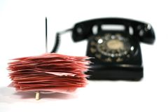 Vintage Phone and Messages. Vintage phone and a pile of pink messages Stock Photography