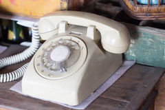 Vintage phone with old wooden table Stock Image