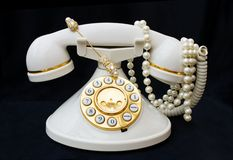 Vintage phone with pearls with clipping path royalty free stock photos