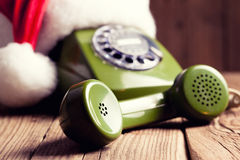 Vintage phone with Santa's hat Stock Image
