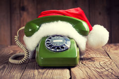 Vintage phone with Santa's hat Royalty Free Stock Photos