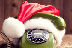 Vintage phone with Santa's hat Stock Images