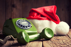 Vintage phone with Santa's hat Royalty Free Stock Images