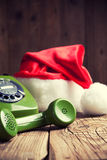Vintage phone with Santa's hat Stock Photography