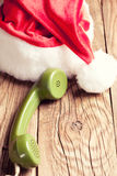 Vintage phone with Santa's hat Royalty Free Stock Image
