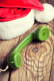 Vintage phone with Santa's hat Stock Photos