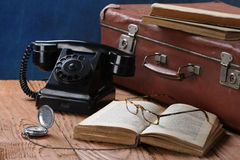 Vintage phone, suitcase, watches and old books Royalty Free Stock Image