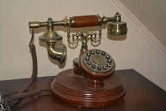 Vintage phone on the table royalty free stock photography