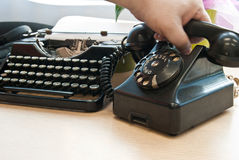 Vintage phone and typewriter Stock Photography