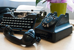 Vintage phone and typewriter Stock Image