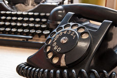 Vintage phone and typewriter Royalty Free Stock Photos
