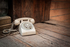 Vintage phone on wood background Stock Photos