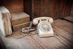 Vintage phone on wood background Royalty Free Stock Images