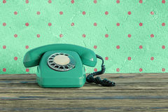 Vintage phone. On a wooden table royalty free stock photo