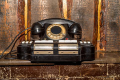 Vintage phoneon the bookshelf background. Vintage retro phone with answering machine in the office on the bookshelf background royalty free stock photography