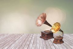 Vintage phonograph, record player, gramophone on Multicolored de. Focused bokeh lights for background or texture Stock Photography