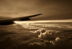 Vintage photo of aircraft wing above the beautiful clouds.Horizontal Stock Image