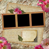 Vintage Photo Album. The frame is decorated with a bouquet of flowers hollyhocks Royalty Free Stock Photography