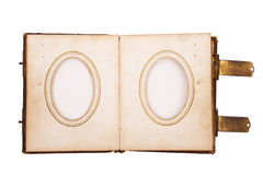 Vintage photo album. A blank vintage photo album with oval frames isolated on white Royalty Free Stock Photo